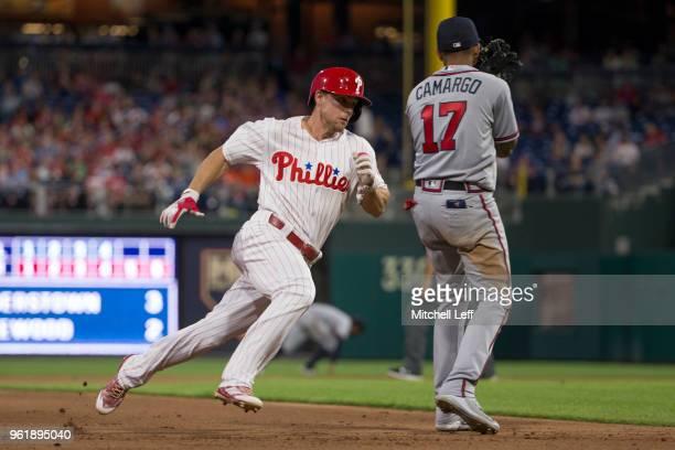Scott Kingery of the Philadelphia Phillies runs past Johan Camargo of the Atlanta Braves to score a run in the bottom of the fourth inning at...