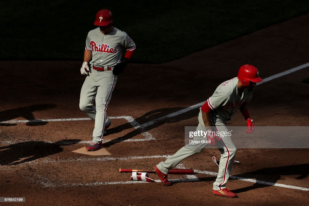 Scott Kingery #4 of the Philadelphia Phillies scores a run after J.P. Crawford #2 drew a walk in the sixth inning against the Milwaukee Brewers at Miller Park on June 16, 2018 in Milwaukee, Wisconsin.
