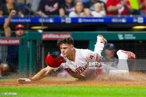 Scott Kingery of the Philadelphia Phillies slides home safely on his insidethepark home run in the bottom of the third inning against the Atlanta...