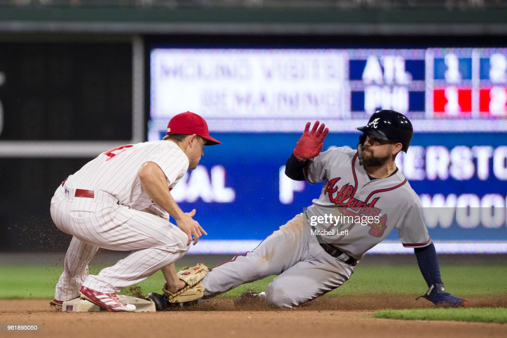 Scott Kingery #4 of the Philadelphia Phillies tags out Ender Inciarte #11 of the Atlanta Braves trying to steal second base in the top of the seventh inning at Citizens Bank Park on May 23, 2018 in Philadelphia, Pennsylvania. The Phillies defeated the Braves 4-0.