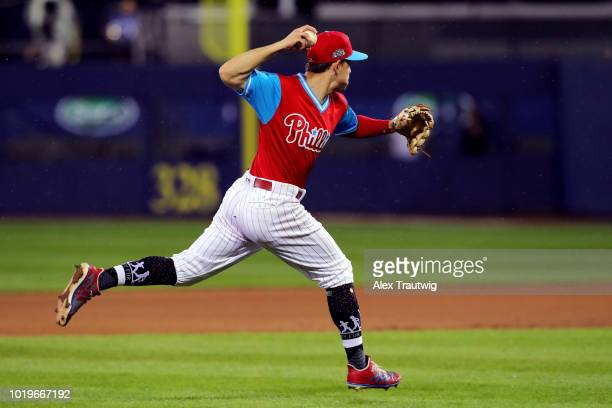 Scott Kingery of the Philadelphia Phillies throws to first base for the out during the 2018 Little League Classic against the New York Mets at...