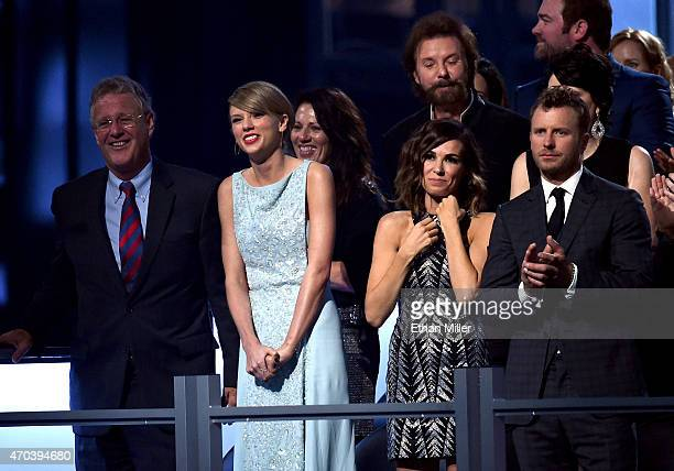 Scott Kingsley Swift honoree Taylor Swift singer Ronnie Dunn of Brooks Dunn Cassidy Black and recording artist Dierks Bentley attend the 50th Academy...