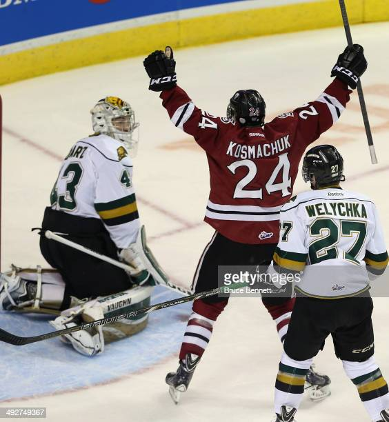 Scott Kosmachuk of the Guelph Storm celebrates his goal at 556 of the first period against Anthony Stolarz of the London Knights during the 2014...