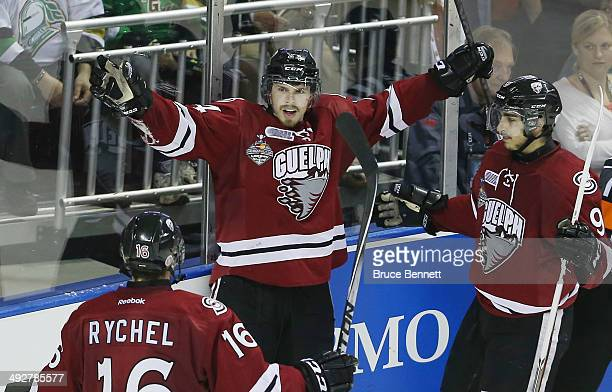 Scott Kosmachuk of the Guelph Storm celebrates his third goal of the game against the London Knights during the 2014 Memorial Cup tournament at...