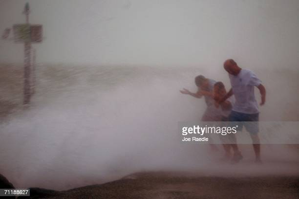 Scott Kuffer Christian Kuffer and Scott Kuffer are hit by waves that are crashing ashore from Tropical Storm Alberto in the Gulf of Mexico June 12...