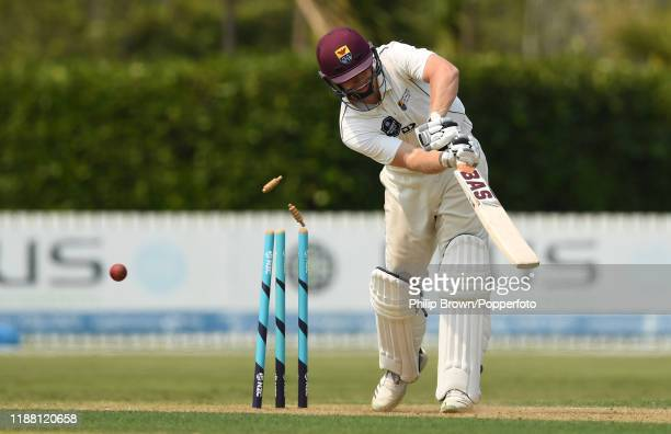 Scott Kuggeleijn of the New Zealand XI is bowled by Sam Curran of England at Cobham Oval on November 17 2019 in Whangarei New Zealand