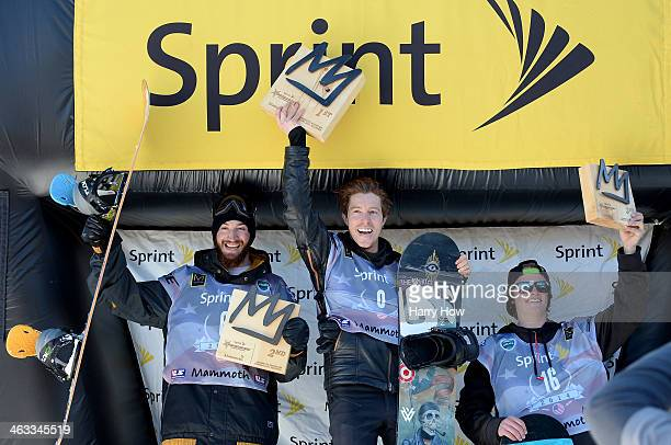 Scott Lago in second place Shaun White in first place and Taylor Gold in third place react on the podium during the Men's Halfpipe Final US Olympic...