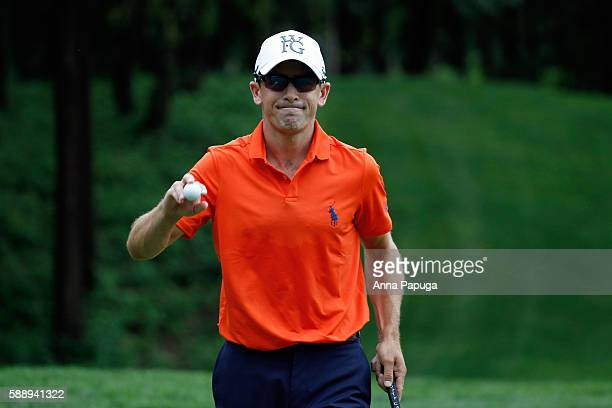 Scott Langley acknowledges the crowd after his shot on the ninth hole during the continuation of the first round of the John Deere Classic at TPC...