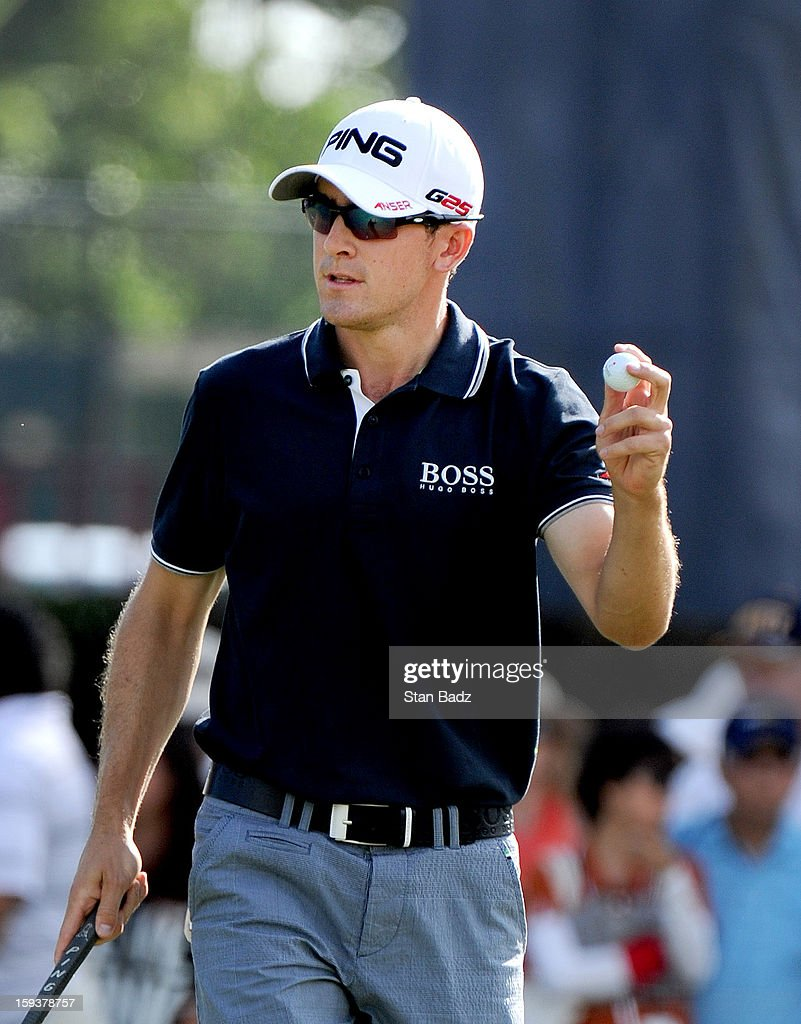 Scott Langley waves his golf ball as he exits the ninth hole during the third round of the Sony Open in Hawaii at Waialae Country Club on January 12, 2013 in Honolulu, Hawaii.