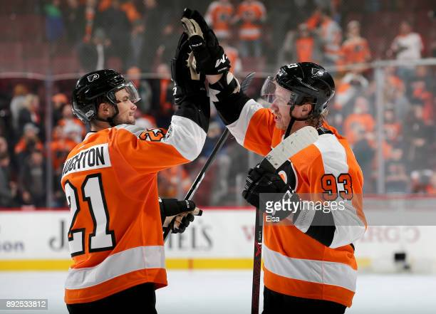 Scott Laughton and Jakub Voracek of the Philadelphia Flyers celebrate the win over the Toronto Maple Leafs on December 12 2017 at Wells Fargo Center...