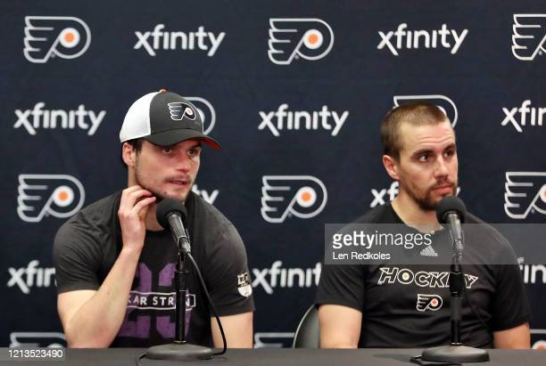 Scott Laughton and Matt Niskanen of the Philadelphia Flyers speak to the media after being defeated 20 by the Boston Bruins on March 10 2020 at the...