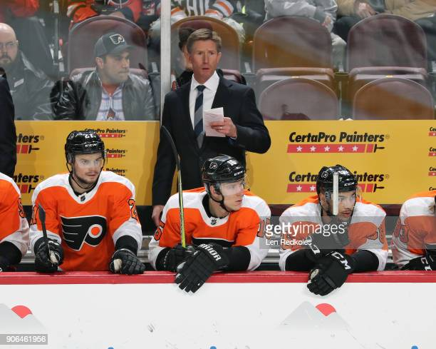 Scott Laughton Jori Lehtera Tyrell Goulbourne and Head Coach Dave Hakstol of the Philadelphia Flyers watch the play on the ice against the Buffalo...
