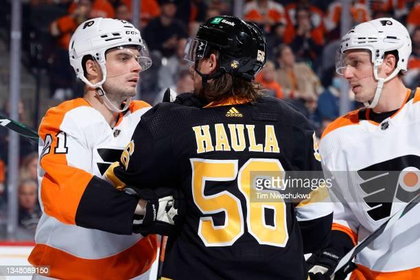 Scott Laughton of the Philadelphia Flyers and Erik Haula of the Boston Bruins tangle at Wells Fargo Center on October 20, 2021 in Philadelphia,...