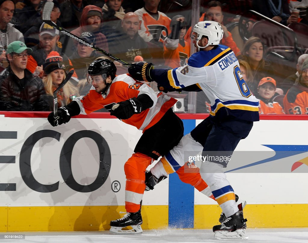 Scott Laughton #21 of the Philadelphia Flyers and Joel Edmundson #6 of the St. Louis Blues collide on January 6, 2018 at Wells Fargo Center in Philadelphia, Pennsylvania.