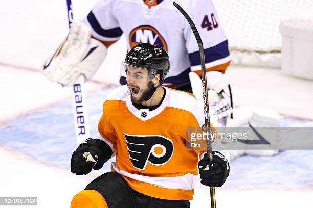 Scott Laughton of the Philadelphia Flyers celebrates after scoring the game-winning goal against the New York Islanders during the first overtime...