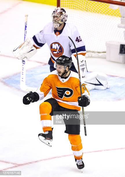 Scott Laughton of the Philadelphia Flyers celebrates after scoring the game-winning goal past Semyon Varlamov of the New York Islanders during the...