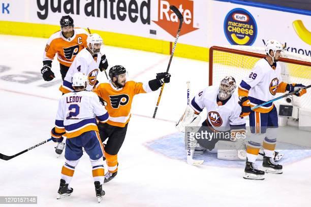Scott Laughton of the Philadelphia Flyers celebrates after scoring the game-winning goal past Semyon Varlamov of the New York Islanders during the...