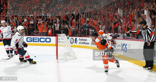 Scott Laughton of the Philadelphia Flyers celebrates his first period shorthanded goal against Alex Ovechkin and the Washington Capitals on October...