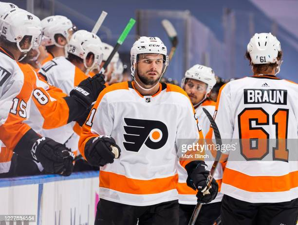 Scott Laughton of the Philadelphia Flyers celebrates his goal against the Boston Bruins during the third period in a Round Robin game during the 2020...