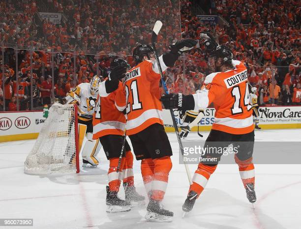 Scott Laughton of the Philadelphia Flyers celebrates his second period goal against Matt Murray of the Pittsburgh Penguins in Game Six of the Eastern...