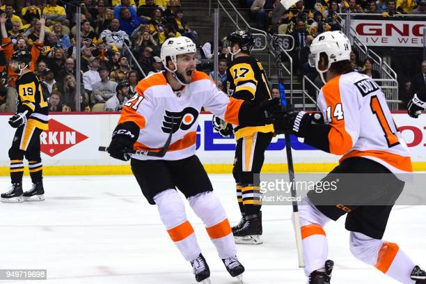 Scott Laughton of the Philadelphia Flyers celebrates Sean Couturier's game winning goal against the Pittsburgh Penguins in Game Five of the Eastern...