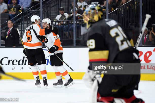 Scott Laughton of the Philadelphia Flyers celebrates with teammates after scoring a goal during the second period against the Vegas Golden Knights at...
