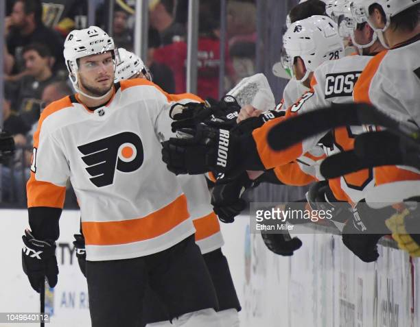 Scott Laughton of the Philadelphia Flyers celebrates with teammates on the bench after scoring a secondperiod goal against the Vegas Golden Knights...