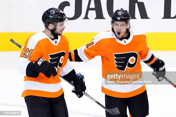 Scott Laughton of the Philadelphia Flyers celebrates with Travis Konecny after scoring a goal on Braden Holtby of the Washington Capitals during the...