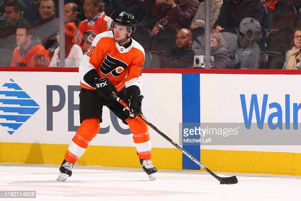 Scott Laughton of the Philadelphia Flyers controls the puck against the Toronto Maple Leafs at the Wells Fargo Center on December 3, 2019 in...