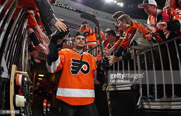 Scott Laughton of the Philadelphia Flyers enters the ice surface for warmups prior to playing the Winnipeg Jets on March 28 2016 at the Wells Fargo...