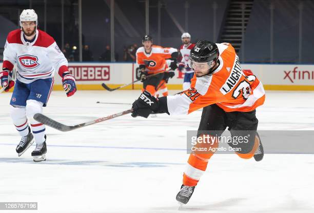 Scott Laughton of the Philadelphia Flyers follows through on his shot in the second period of Game One of the Eastern Conference First Round of the...