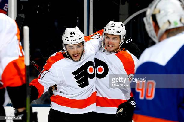 Scott Laughton of the Philadelphia Flyers is congratulated by his teammate Phil Varone after scoring a second period goal against the New York...