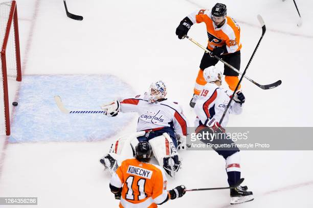 Scott Laughton of the Philadelphia Flyers scored a goal on Braden Holtby of the Washington Capitals during the first period in the Eastern Conference...