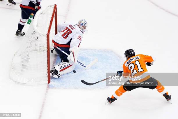 Scott Laughton of the Philadelphia Flyers scores a goal on Braden Holtby of the Washington Capitals during the third period in the Eastern Conference...