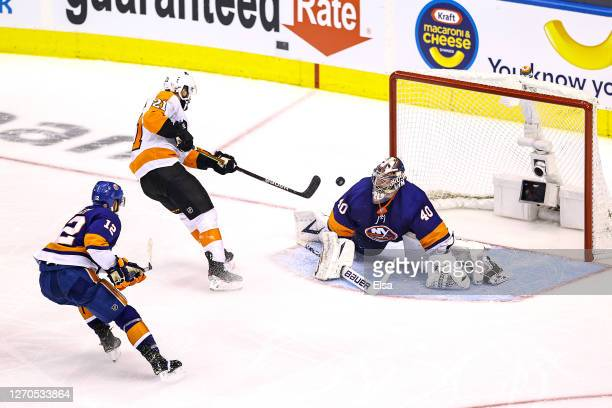 Scott Laughton of the Philadelphia Flyers scores a goal past Semyon Varlamov of the New York Islanders during the third period in Game Six of the...