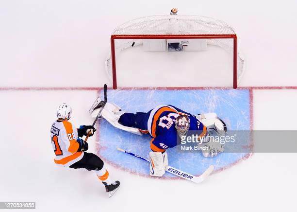 Scott Laughton of the Philadelphia Flyers scores on a breakaway against goaltender Semyon Varlamov of the New York Islanders in the third period of...
