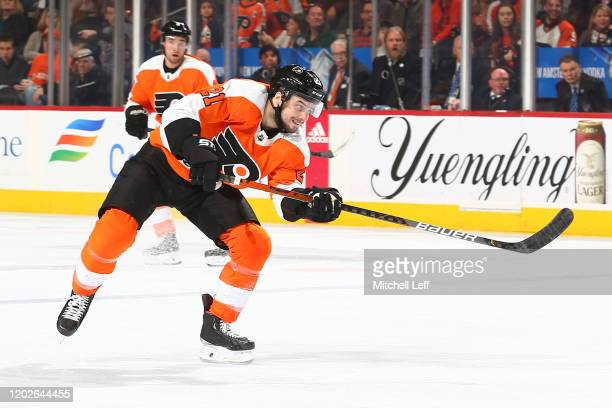 Scott Laughton of the Philadelphia Flyers shoots the puck against the Winnipeg Jets in the third period at the Wells Fargo Center on February 22,...
