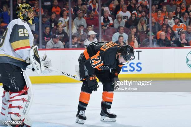 Scott Laughton of the Philadelphia Flyers skates off the ice injured past MarcAndre Fleury of the Vegas Golden Knights at the Wells Fargo Center on...
