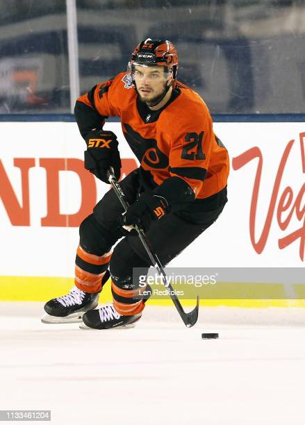Scott Laughton of the Philadelphia Flyers skates the puck against the Pittsburgh Penguins at the 2019 Coors Light NHL Stadium Series on February 23...