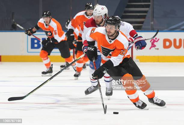 Scott Laughton of the Philadelphia Flyers skates with the puck in the second period of Game One of the Eastern Conference First Round of the 2020 NHL...