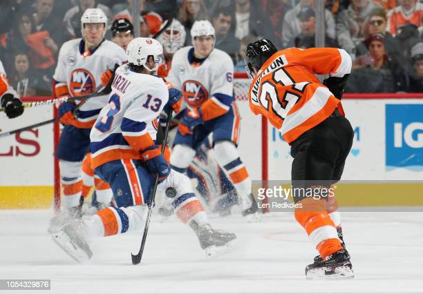 Scott Laughton of the Philadelphia Flyers takes a shot that hits the knee of Matthew Barzal of the New York Islanders on October 27 2018 at the Wells...