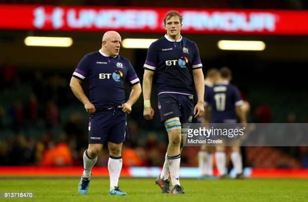 Scott Lawson and Jonny Gray of Scotland leave the pitch following their defeat during the Natwest Six Nations round One match between Wales and...