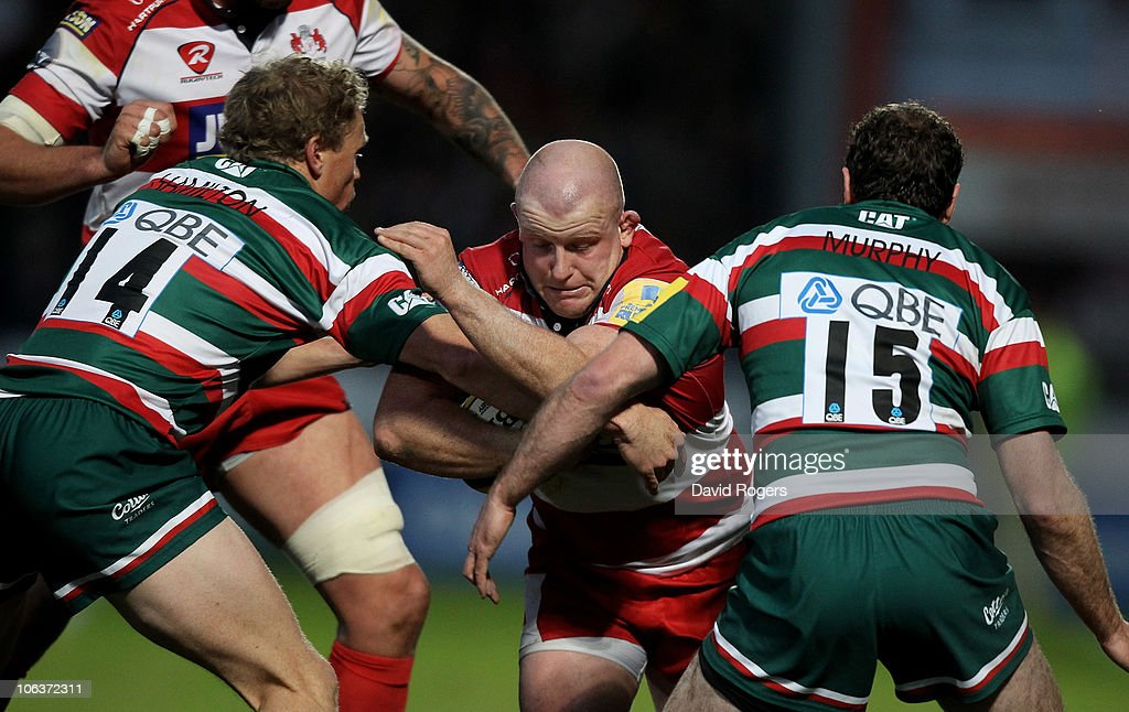 Scott Lawson of Gloucester is tackled by Scott Hamilton and Geordan Murphy (R) during the Aviva Premiership match between Gloucester and Leicester Tigers at Kingsholm on October 30, 2010 in Gloucester, England.