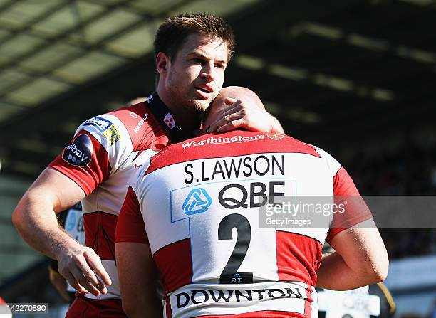 Scott Lawson of Gloucester Rugby celebrates with team mate Henry Trinder after scoring a try during the AVIVA Premiership match between London Wasps...