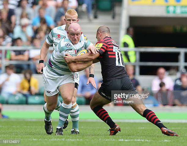 Scott Lawson of London Irish is tackled by Charlie Hodgson during the Aviva Premiership match between Saracens and London Irish at Twickenham Stadium...