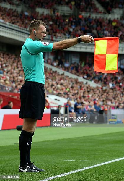 Scott Ledger holds up his offside flag during the Premier League match between Middlesbrough and Crystal Palace at Riverside Stadium on September 10...