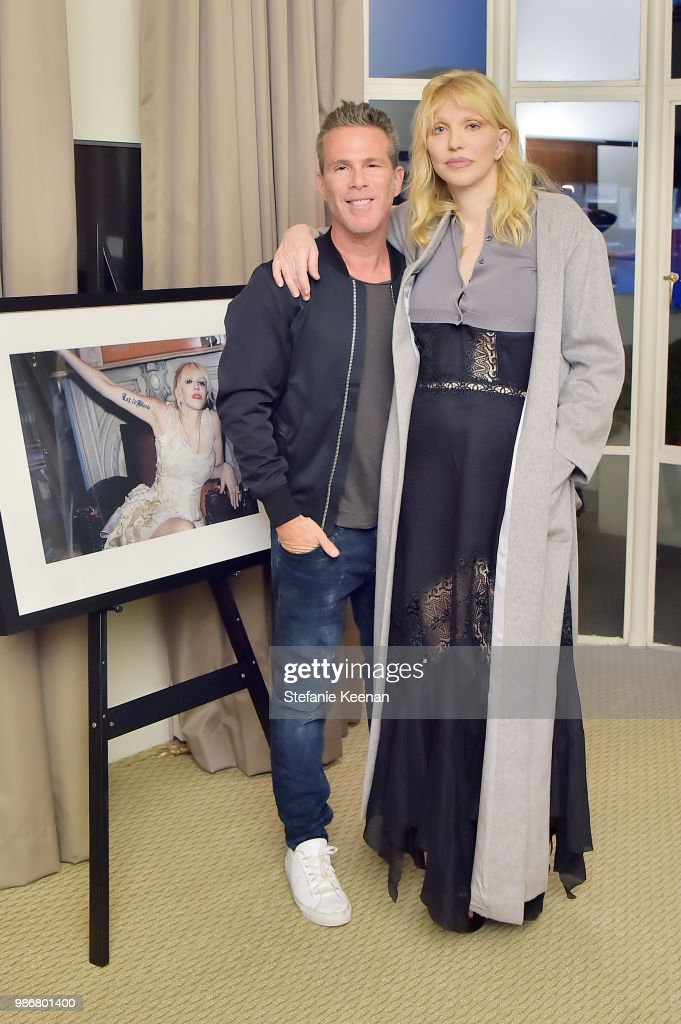 Scott Lipps (L) and Courtney Love attend Diesel Presents Scott Lipps Photography Exhibition 'Rocks Not Dead' at Sunset Tower on June 28, 2018 in Los Angeles, California.