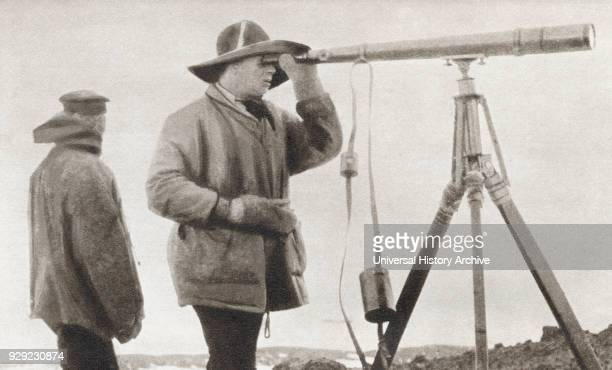 Scott looking through a telescope during The Terra Nova Expedition to the south pole in 1912 Robert Falcon Scott 1868 – 1912 Royal Navy officer and...