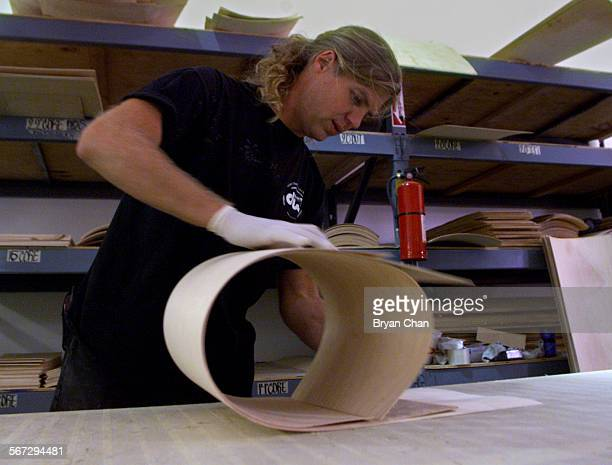 Scott Luedke rolls thin plywood to make drum shell at Drum Workshop in Oxnard. The company was founded by Don Lombardi andJohn Good. They make a line...
