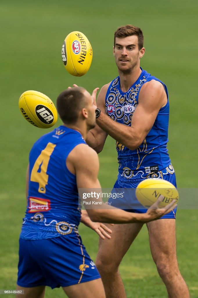 Scott Lycett and Dom Sheed work on a drill during a West Coast Eagles AFL training session at Subiaco Oval on May 29, 2018 in Perth, Australia.